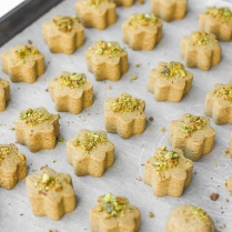 Nan-e nokhodchi (Persian chickpea cookies) is a crumbly, melt-in-your-mouth cookie, made with the fragrant flavours of rose water, cardamom and pistachio. | aheadofthyme.com